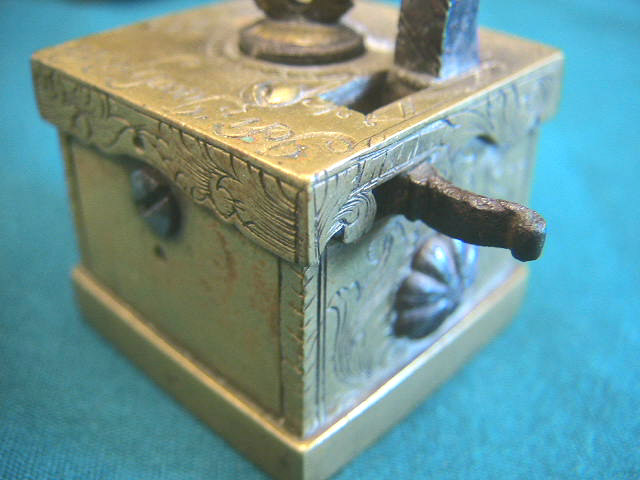 "Extremely rare version of a common Viennese (Wien) brass scarificator.  This item is identical in form to the pieces seen elsewhere on the site.  The pieces all have a typical square brass construction with the heart or crown shaped depth screw and 5-6-5 blade configuration.  This piece is unique in its ornate engraving and inscription of ""Joh Jacob Fischer in Wien"" and the addition of a 1755 date mark."