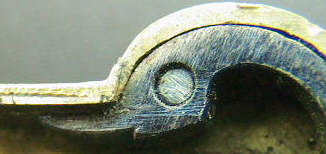 Brass silver spring lancet with ornate engraving marked Andreas Fischer and dated 1790.  Note the similarities to the release bar design and the zoomorhic design of the swan's head finial to the drive spring.  The piece is seen on the page of brass spring lancets.