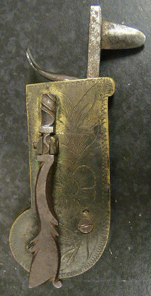 "Ornately engraved brass and steel Veterinary spring lancet.  The piece has a beautifully worked release bar.  The item is marked with the makers mark: a reverge ""G"" and conjoined ""B"".  The leather case is marked with the GB on either side of what looks like a beehive.  American in origin c.1780-1800.  An identical piece can be found on the Old Sturbridge Village website."