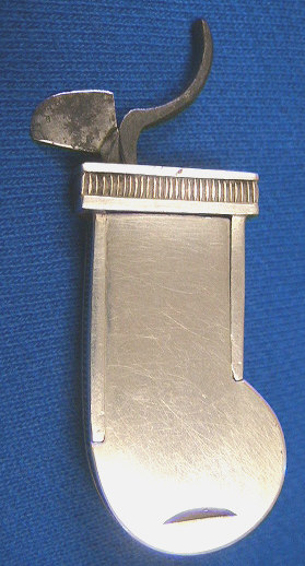 Beautiful silver cased bar release spring lancet.  The item is contained in a red leather case with gold trim.  The release is ornately tooled.  The inside of the case is marked Jackson Baltimore.  A similar item is seen on Bob Greenspan's site and is thought to have been  created by Samuel Jackson the silversmith.