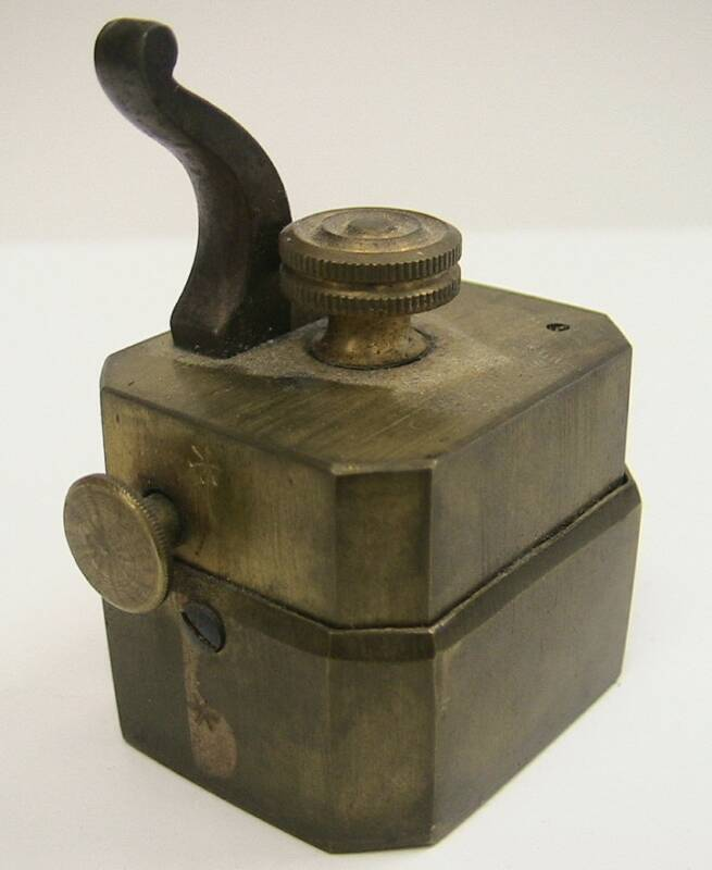 Small unmarked brass temple scarificator.  Note the presence of only 6 blades.  Designed to bleed very small areas of the body.